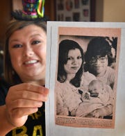 Mandy Young holds a copy of a newspaper clipping of when she was the only baby born in Tomah, Wisconsin on Februry 29, 1984, whcih was a leap year.