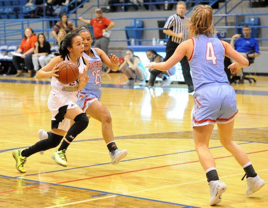 Rider's Ashlynn Knight drives to the basket with Lubbock Monterey's Alyssa Trevino (25) and Taysha Rushton (4) defending in a Region I-5A quarterfinals matchup at Childress on Monday, Feb. 24, 2020.