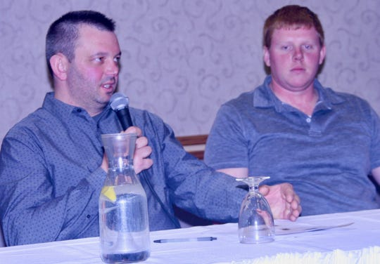Farmer panelists Aaron Augustian, left, and Pat Kane share details of their cropping success despite an especially wet planting and harvest season.
