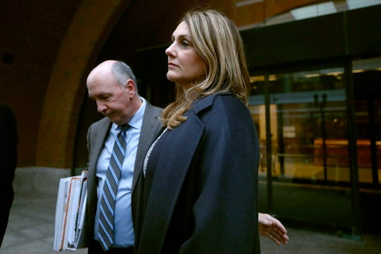 Michelle Janavs stands with attorney Thomas Bienert outside federal court, Tuesday, Feb. 25, 2020, in Boston, after she was sentenced to five months in prison for trying to cheat and bribe her daughters' way into college as part of a nationwide college cheating scam.