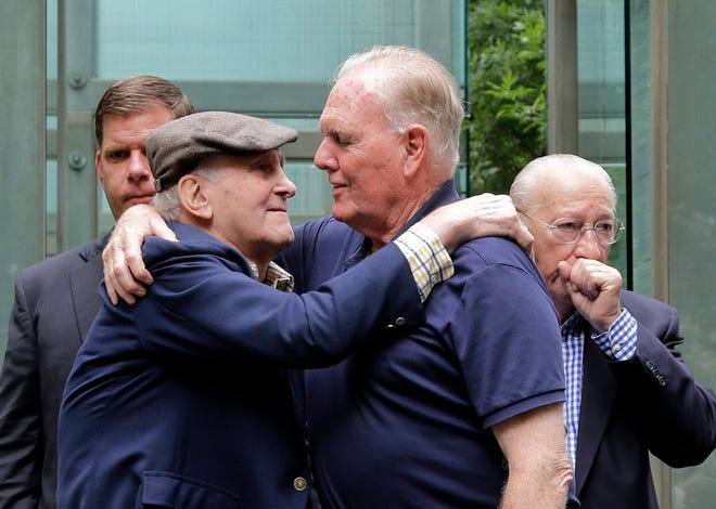 In this July 11, 2017, file photo, Holocaust survivor Steve Ross, left, founder of the New England Holocaust Memorial, embraces former Boston Mayor Raymond Flynn during a a rededication ceremony for the repaired New England Holocaust Memorial in Boston. Ross, a Holocaust survivor, died Monday, Feb. 24.