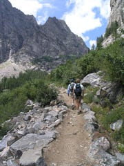 Visitors to Grand Teton National Park hike through Death Canyon, which was carved by glaciers about 15,000 years ago.