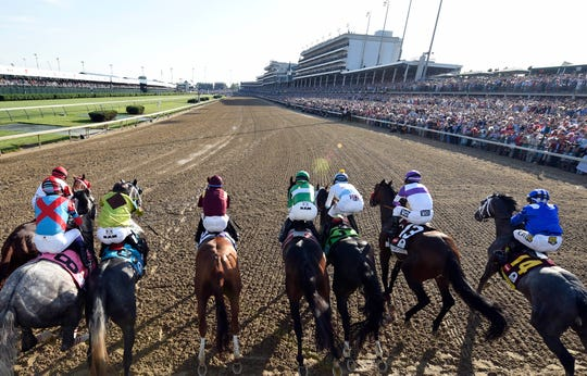 A general view as the field of horses breaking from the starting gate during the 142nd running of the Kentucky Derby at Churchill Downs in 2016.