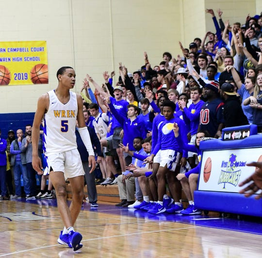 Wren junior Bryce McGowens(5) looks toward the crowd after scoring a three-pointer during the second quarter of the Class AAAA playoff game at Wren High School in Piedmont Tuesday.