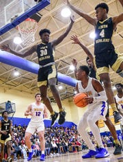 Wren junior Josh Owens(23) fakes out three Lower Richland players during the first quarter of Class AAAA playoff game at Wren High School in Piedmont Tuesday.  Hurricanes win 74-69.