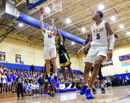 Wren senior Eli Wilson(12) scores after a pass from Wren junior Bryce McGowens(5) during the fourth quarter of the Class AAAA playoff game at Wren High School in Piedmont Tuesday.