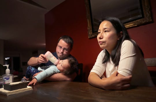 Daisy Roth, right, of Neenah, recounts being trapped in Wuhan, China during the coronavirus outbreak, and her and her two young daughters' subsequent evacuation out of the country and stay in quarantine on a California air force base.