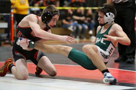 Stevens Point senior Justin Groshek, left, has a 42-0 record heading into the Division 1 state wrestling tournament Thursday in Madison.