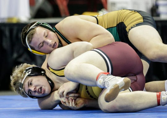 Edgar's Ethan Heil, top, has a 28-0 record at 220 pounds this year after finishing as the state runner-up in Division 3 last season.