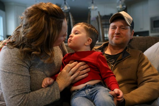 Brenna and Joel Siebold hold their son, Leo, 2, at their home in Mount Horeb on Feb. 14. Leo has heterotaxy syndrome, a condition in which his internal organs are abnormally arranged, causing frequent hospital visits for the family. On Sept. 5, 2018, Leo was taken to the American Family Children's Hospital in Madison with a fever. Medical personnel reported them for possibly abusing the then 9-month-old, citing tiny bruises on his body. Although they were cleared of the allegations, the Siebolds say the episode left them with lingering trauma.