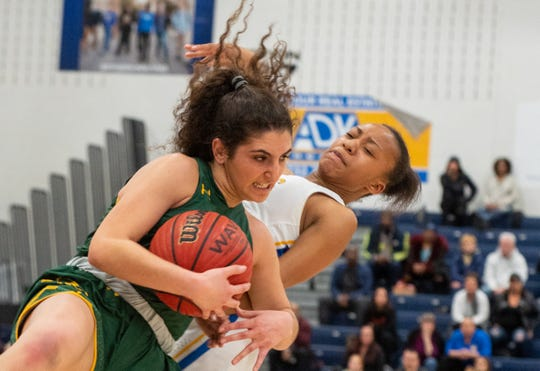 Antonia Pannyides of RBC grabs a loose ball against Manchester.  Manchester Township beat Red Bank Catholic in a  Shore Conference Tournament girls basketball semifinal game played at the RWJBarnabas Health Arena in Toms River on Tuesday, February 25, 2020. / Russ DeSantis for the Asbury Park Press