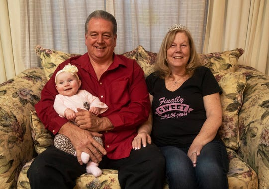 Bill and Kathie Kinder in their Brick home with their 4-month-old granddaughter Raelynn Noreen Rodger.