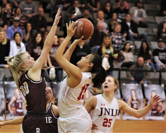 Jim Ned's Alexis Espinosa (15) shoots over Bowie's Jayci Logan, left, as Claire Graham (25) looks on in the second half. Jim Ned beat the Lady Rabbits 46-39 in the Region I-3A quarterfinal playoff game Tuesday, Feb. 25, 2020, in Cisco.