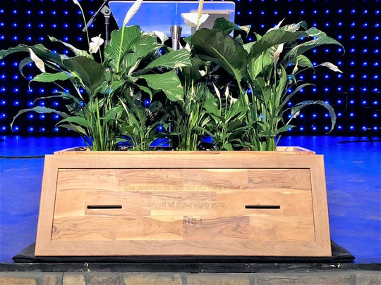 During the funeral for accountant Gary Morrison on Wednesday, a commitment box he made of wood from Israel in support of a 2008 Beltway Park Church building project was displayed at the front of the auditorium.
