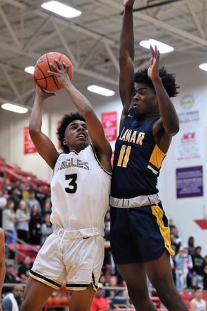 Abilene High's Jalen McGee (3) goes up for a contested shot at the basket during the Region I-6A bi-district playoff against Arlington Lamar on Feb. 25 in Mineral Wells. The Eagles fell 60-47. McGee is one of seven returning players for AHS this season.