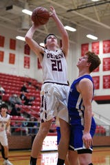De Leon's Ryley McGinnis (2) goes up for a shot over a Windthorst defender during the Region II-2A bi-district playoff in Mineral Wells on Tuesday. McGinnis scored 14 points in the 65-60 Bearcat victory.