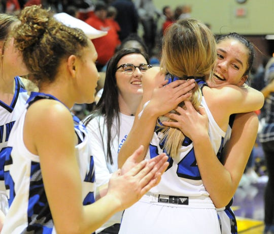 Stamford teammates Citlaly Gutierrez and Shandlee Mueller (32) hug after beating Albany in a Region I-2A quarterfinal Tuesday, Feb. 25, 2020, at Hardin-Simmons' Mabee Athletic Complex in Abilene.