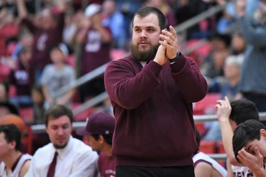 First-year De Leon coach Colby Quillin claps his hands after a made basket late in the Region II-2A bi-district playoff against Windthorst in Mineral Wells on Tuesday. The Bearcats won 65-60 to advance.