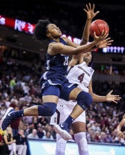 South Carolina forward Aliyah Boston (4) goes for a block against UConn's Christyn Williams during their game Feb. 10 in Columbia.