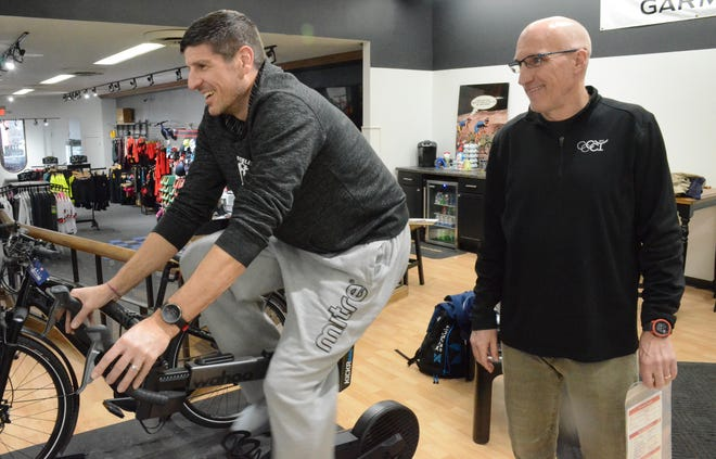 Mike Wood, right, supervises Sebastien Bellin on a trainer at Wood's downtown Battle Creek store.