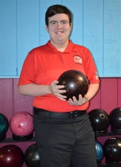 Caden LaTour, a special needs athlete in the special education program at Marshall, bowls with the Redhawks high school bowling team.