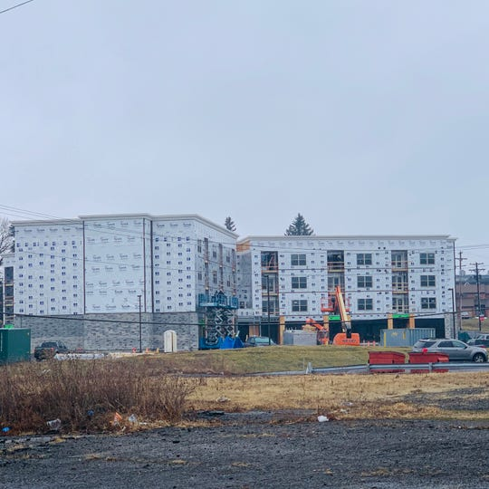 Construction for the Canal Project, which will house a grocery store on the lower level and housing above.