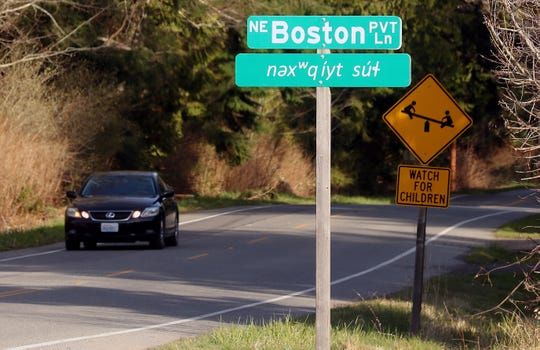 NE Boston LN is translated into Klallam in the sign below it in Little Boston on Wednesday, Feb. 26, 2020.