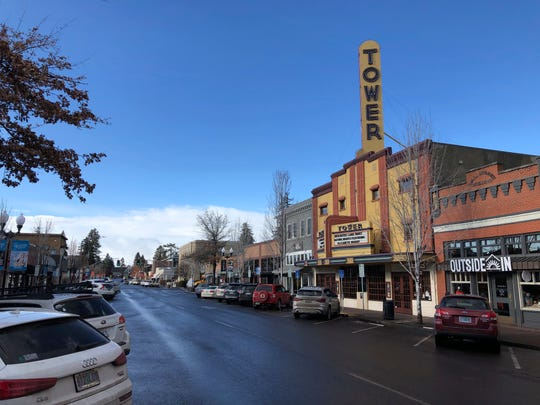 This Jan. 28, 2020 photo shows the Tower Theatre located in downtown Bend, Oregon, where the population in the early 1990s was around 25,000 and leaned Republican.