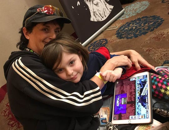 FLORIDA TODAY columnist Britt Kennerly and her great-niece, Emmy, pictured at the Orlando Toy & Comic Con, communicate, often, via Messenger, and share a love of books, space and the absurd.