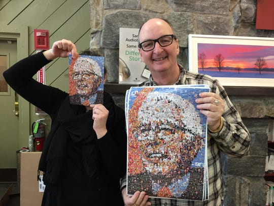 Assistant manager Christy Richardson and manager Tod Gross display Bernie Sanders posters for sale at Phoenix Books in Burlington on Feb. 19, 2020.
