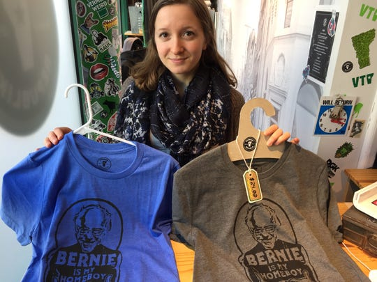 """Emma Wright holds """"Bernie is my homeboy"""" T-shirts at the Vermont Republik store on Church Street in Burlington on Feb. 21, 2020."""