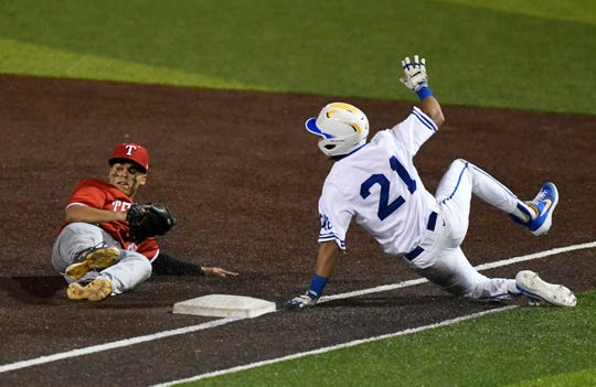 Ray's Isaac Flores, left, tags Moody's Ryan Espinosa out during the seventh inning, Tuesday, Feb. 25, 2020, at Cabaniss Baseball Field. Ray won, 4-1.
