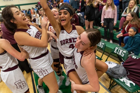 The Flour Bluff girls basketball team celebrates after beating Carroll 42-25 in the Class 5A regional quarterfinals at King High School on Tuesday, Feb. 25, 2020.