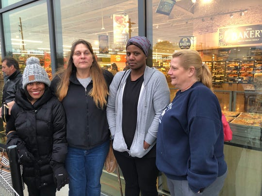 Sharon Davis of Cherry Hill (from left), Holly Sharman of Cherry Hill, Loretta Williams of Haddon Heights and Francine Turner of Williamstown bonded Wednesday morning as they waited for the new Lidl to open in Cherry Hill. Turner, the first in line, arrived at 3 a.m., five hours before the opening.