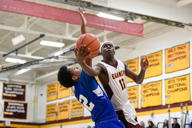Haddon Heights' D'Layne Peterson (11) maneuvers for a shot against Williamstown in Haddon Heights, N.J. Tuesday, Feb. 25, 2020. Haddon Heights won 61-45.