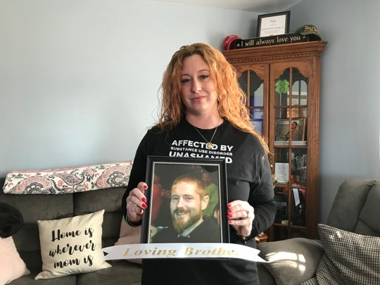 Kristen Rivera holds a photo of her brother, Kenny Arnold, who died of fentanyl toxicity in November 2018. She's on a mission to spread the word about the dangers of the synthetic opioid.