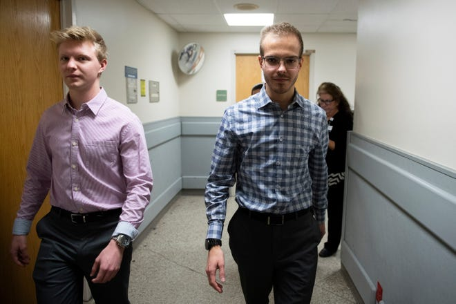 Twins Paul, left, and Phillip Kumpf, 22, walk the halls of Jefferson Stratford Hospital, where they used to volunteer.