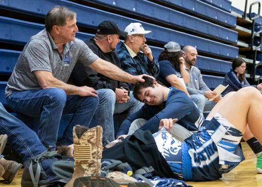Keith Kauffman puts his hand on his grandson Dalton Metzger's head as they wait to wrestle during a tri match at Adena High School on Jan. 23, 2020.