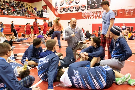 Adena Head Coach Dalton Moss meets with several of his wrestlers during a tournament break at the Logan Elm Wrestling Invitational on Jan. 4, 2020, in Circleville, Ohio.