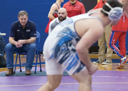 Keith Kauffman sits in the coach's chair as Dalton wrestles during the SVC tournament. Kauffman has constantly sat in on his grandsons wrestling matches since he was a freshman.