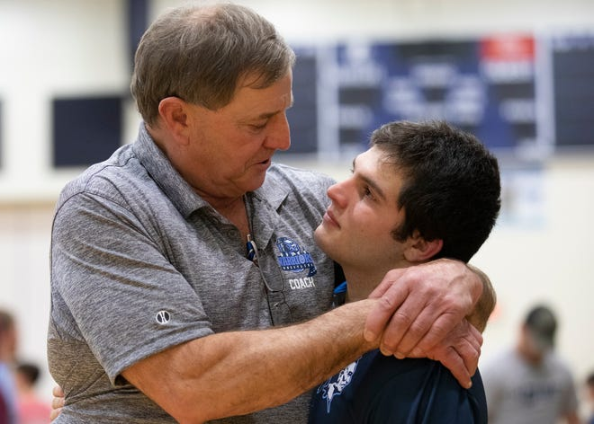 Keith Kauffman, left, hugs his grandson, Dalton Metzger, after a wrestling tri meet against Unioto and East Clinton in Frankfort, Ohio, on Jan. 23, 2020. Without his grandfather, Metzger believes he would not have been as successful nor stayed with wrestling.