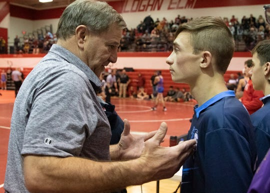 Coach Kauffman talks with James Gregory before wrestling at Logan Elm earlier in the year.