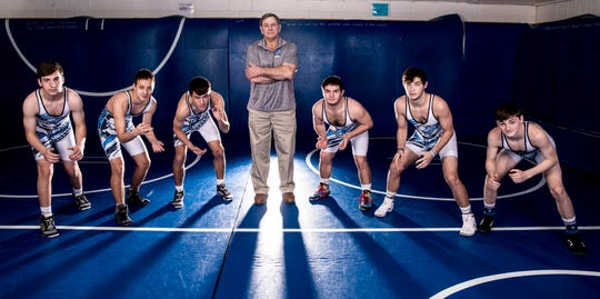 Kauffman poses with the current Adena varsity team. (L-R)  Chase Knisley, Gabriel Moore, Garrett Simmons, Coach Kauffman, Dalton Metzger, Isaac Gray, and Zach Seymour.