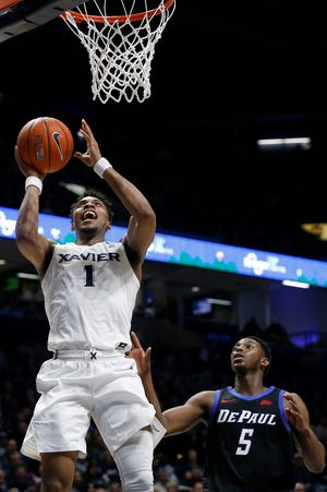 Xavier Musketeers guard Paul Scruggs (1) rises for a shot in the first half of the NCAA Big East basketball game between the Xavier Musketeers and the DePaul Blue Demons at the Cintas Center in Cincinnati on Tuesday, Feb. 25, 2020.