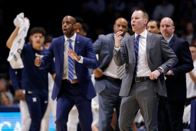 Xavier Musketeers head coach Travis Steele directs his defense in the first half of the NCAA Big East basketball game between the Xavier Musketeers and the DePaul Blue Demons at the Cintas Center in Cincinnati on Tuesday, Feb. 25, 2020.