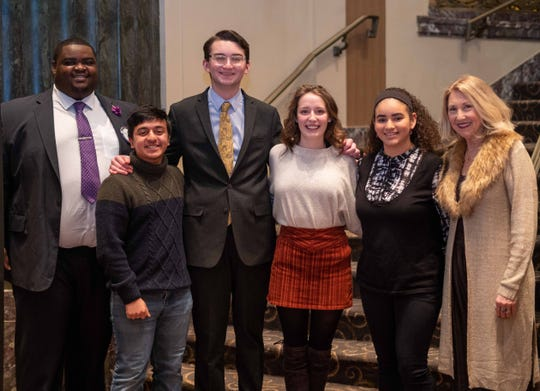 Local high school students competed in the Cincinnati Rotary's annual speech contest. Co-chair Ed Mathis, left, with contestants, from left, Yousuf Munir, Liam O'Shaughnessy, Sarah Johnson and Astrid Coste Pena, and co-chair Laure Quinlivan.