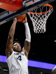 Xavier Musketeers forward Tyrique Jones (4) rises to drop in a shot in the first half of the NCAA Big East basketball game between the Xavier Musketeers and the DePaul Blue Demons at the Cintas Center in Cincinnati on Tuesday, Feb. 25, 2020.
