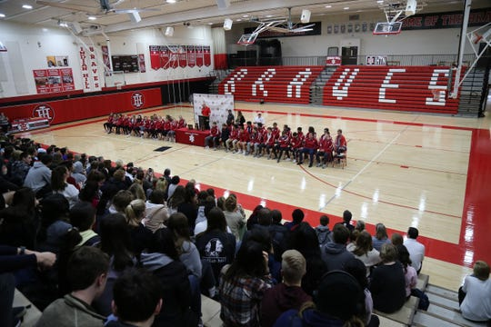 The Indian Hill boys and girls swim team are honored at an assembly at the high school, Tuesday, Feb. 25, 2020.