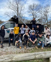 Northeast High ROTC helps riverbank at Billy Dunlop by planting trees.