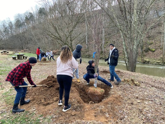 Clarksville Parks & Recreation staff and 16 Northeast High School ROTC students teamed to plant 25 trees at Billy Dunlop Park.